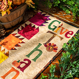 A Year in Words Wall Hanging   How to Make a Pieced Leaf (Bear Paw) Quilt Block