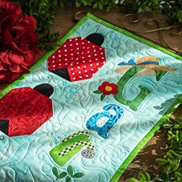 A Year in Words Wall Hanging | How to Make a Pieced Ladybug Block