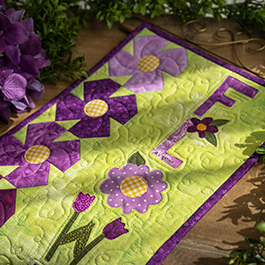 A Year in Words Wall Hanging | How To Make a Pieced Pansy Block